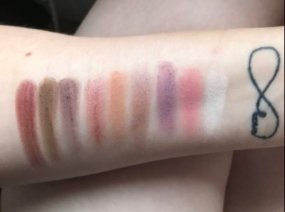You'll have to excuse my scars, but here are the swatches of the eyeshadow palette